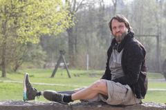 Portrait of man with prosthesis leg in park Stock Photos