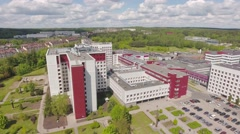 Establishing shot, modern building,  headquarters, hospital, etc. aerial view. Stock Footage