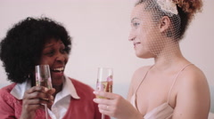 Mother and daughter toasting in bridal studio Stock Footage