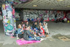 London, UK - June 3, 2012: Youth enjoying a picnic amongst the urban art on the  Stock Photos