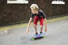 Boy skateboarding Stock Photos