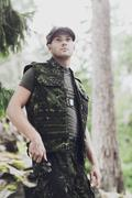 young soldier or hunter with knife in forest - stock photo