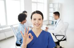 happy doctor over group of medics at hospital - stock photo