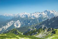 Alps mountains aerial view with paraglider over Alpine landscape - stock photo