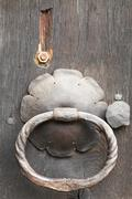 Old cast iron ring handles and escutcheon - stock photo