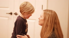 Mother and daughter bump heads and laugh with each other Stock Footage