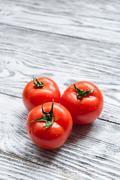 Three red tomatoes Stock Photos