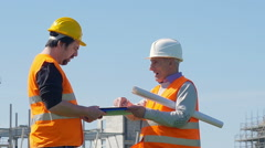 Old foreman explains to a worker interventions to do Stock Footage