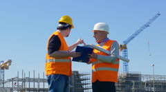 Foreman organizes job with a worker Stock Footage