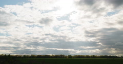 clouds fast move over field and disappear - stock footage