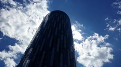Clouds passing by sky scrapper Stock Footage