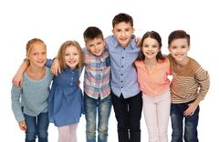 Happy smiling children hugging Stock Photos