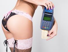 technology, internet and networking  Payment - sexy woman's ass and POS terminal - stock photo