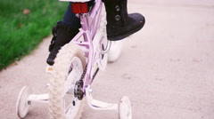 Little girl riding her bike at the park Stock Footage