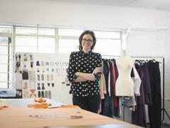 Fashion designer in fashion design studio, portrait - stock photo
