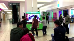 Children dancing with Microsoft demonstrated game - stock footage