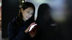 Woman use of mobile phone at night Stock Footage