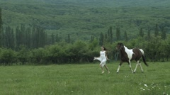 Young Beauty Running With A Horse Stock Footage