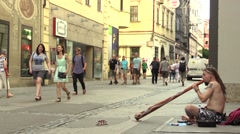 A man plays the didgeridoo on the street, authentic emotional real, good music - stock footage