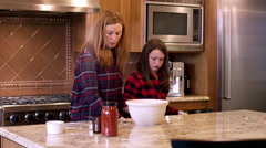 Mother and daughter getting ingredients to cook a meal Stock Footage