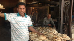 Local man selling egyptian pita bread at Giza Stock Footage