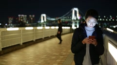 Woman use of mobile phone at Tokyo city Stock Footage