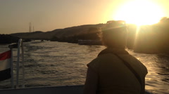 Back view of woman enjoying on boat on Nile river at sunset Stock Footage