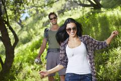 Smiling couple walking in woodlands Stock Photos