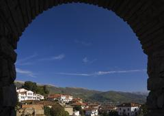 Silhouetted arch view of Ohrid town and mountains, Macedonia, Eastern Europe - stock photo