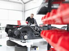 Engineer assembling supercar in sports car factory Stock Photos