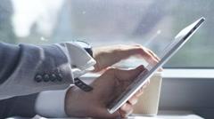 4k Businessman working on digital tablet & drinking coffee on train journey Stock Footage