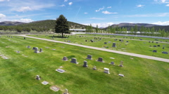 Aerial- low pass over country cemetery Stock Footage