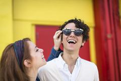 Couple trying on fun sunglasses Stock Photos