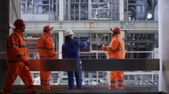 4K Male & female engineers conducting checks at power station Stock Footage
