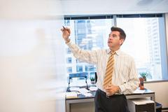 Business lawyer writing on whiteboard in office Stock Photos