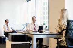 Three business lawyers meeting in office - stock photo