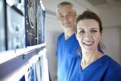 Portrait of radiologists with brain scans Stock Photos