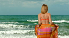 Girl blonde in swimsuit  posing near the sea Stock Footage