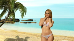 Girl blonde in swimsuit  posing near the sea and enjoys dancing Stock Footage
