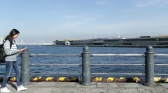 Woman taking photo of Yokohama bay Stock Footage