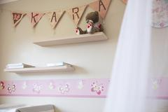 Decorated pink nursery with name on bunting Stock Photos