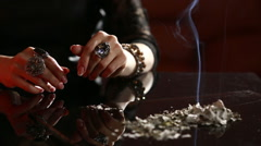 Witch - fortune teller reading fortune close up. smoking ash Stock Footage