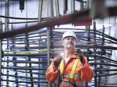 Engineer inspecting cable expansion in suspension bridge. The Humber Bridge, UK, - stock photo