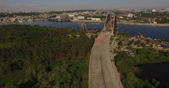 Abandoned unfinished transport bridge over the city and forest Stock Footage