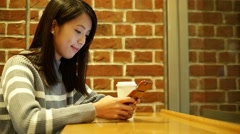 Woman use app on smartphone in cafe - stock footage