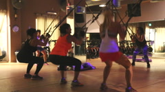 TRX training class in the dark Stock Footage
