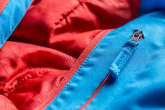 Zipper on blue winter coat Stock Photos