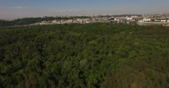 Green forest and city line on the horizon Stock Footage