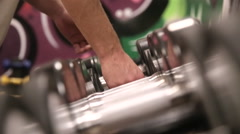 Side view on row of dumbbells Stock Footage