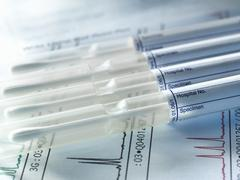 A row of DNA samples from family members being genetically tested for paternity Stock Photos